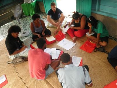 Image: Aidan Craney with Fijian youths during microenterprise training.